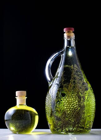 rakia: Olive oil and herb brandy on a black background.