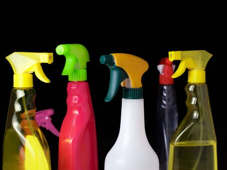 household objects equipment: Cleaning spray bottles isolated on a black background. Stock Photo