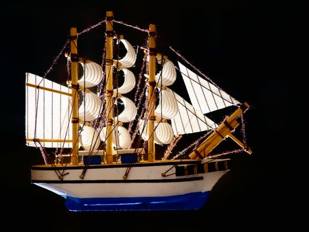 Sail ship model isolated on a white background. photo