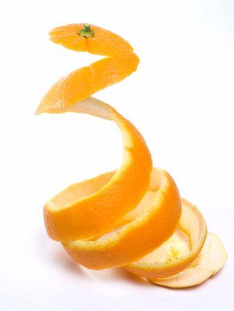 Spiral peeled bark of a ripe orange isolated on white background.
