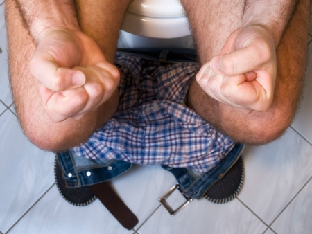 defecation: The metaphor of gastrointestinal problems like constipation or diarrhea Stock Photo