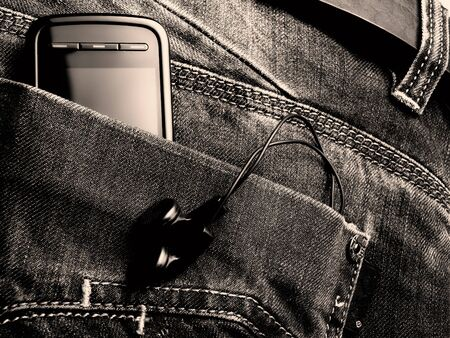 Metaphor about new jeans generation with digital equipment. Toned BW image. photo
