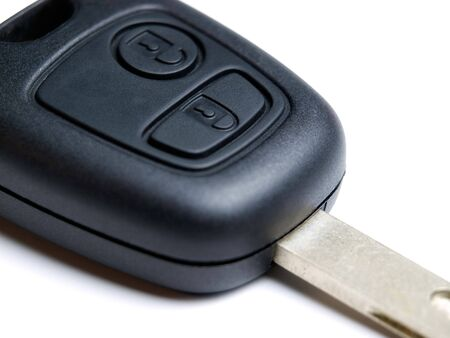 Macro of wireless electronic car key on a white background. photo