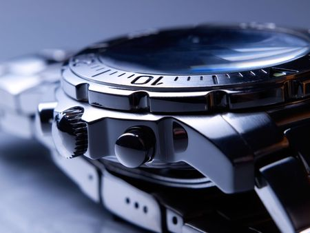 wrist strap: Closeup of steel wrist watch.