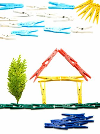 clothes pegs: House and surrounding  outline made from colored clothes pegs, like childrens drawings.