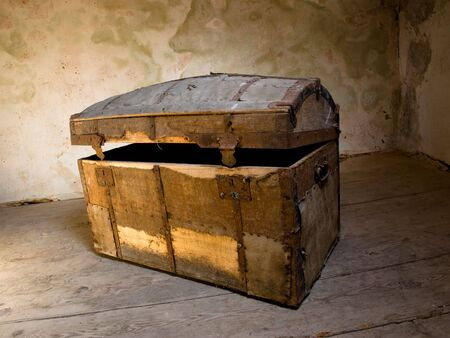 Very old chest like a treasure box in some grunge interior. Stock Photo