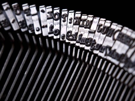 Closeup view of typebars or hammers  on an old  typewriter. photo