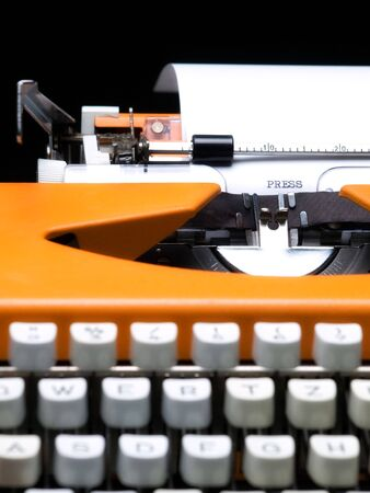 Closeup view of the typewriter and word  PRESS  typed on the paper. Stock Photo - 6991947