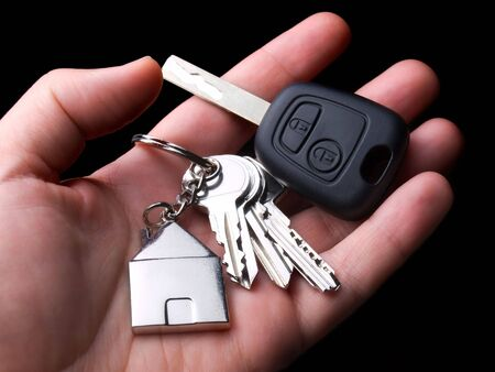 car key: Main symbols of urban standards of living, home and car.