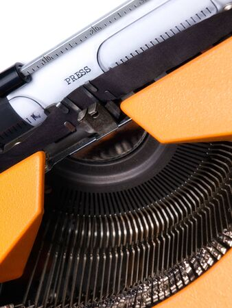 Closeup view of the typewriter and word  PRESS  typed on the paper. Stock Photo - 7035691