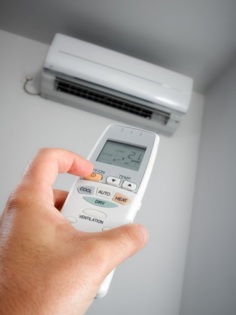 air view: Closeup view about using some appliance such as air condition. Stock Photo