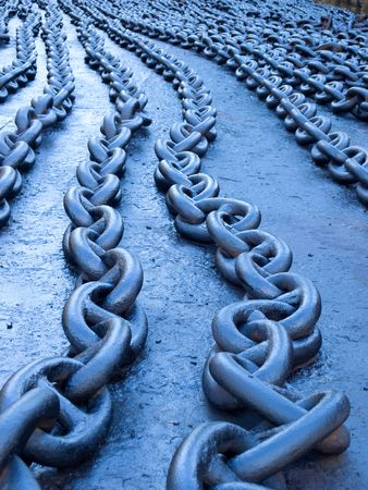 Naturally blue toned ships chains on the dock. Stockfoto