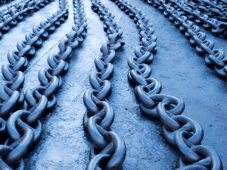 Naturally blue toned ship chains on the dock.