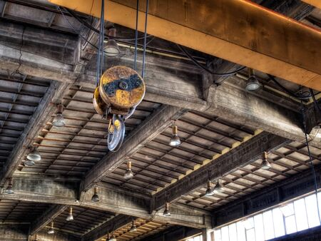 lifting hook: Hook on the crane in an old factory hall. Stock Photo