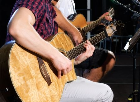 Detail of two guitar players on stage during the concert. Stock Photo