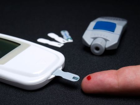 hyperglycemia: Closeup view of testing of  blood glucose and the necessary equipment.