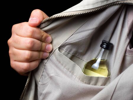 drunkenness: Sight on the booze in drunkards pocket... Stock Photo