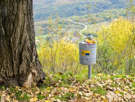 Trash can full of waste somewhere  in the autumnal  environment Stock Photo - 8280287