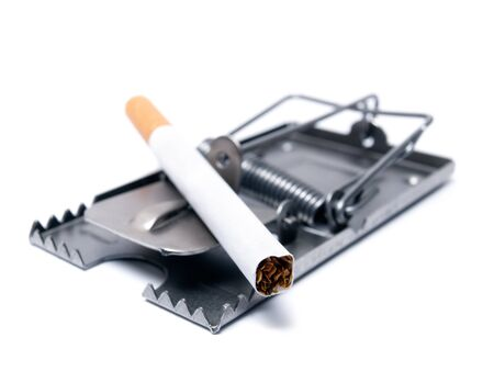 Conceptual view of smoking  presented with a cigarette as a bait on the mousetrap. photo