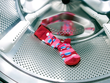 Do not forget the red or colorful  sock in a washing machine! Stock Photo - 8665679