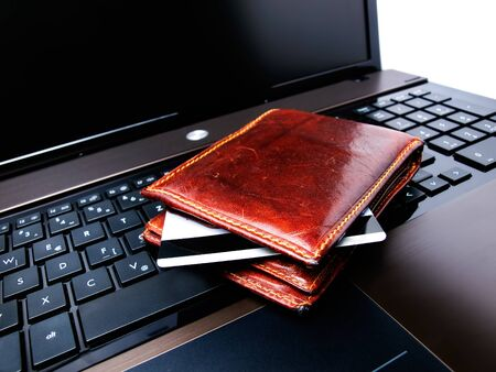 Conceptual view of on-line shopping with credit card,wallet and laptop...