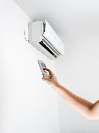 Arm, remote control and air conditioning. Stockfoto