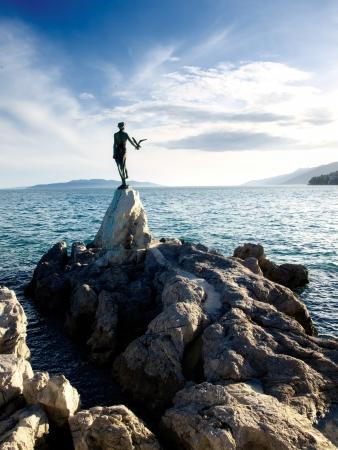 adriatic: This historic statue on the Adriatic coast is a symbol of touristic town Opatija in Croatia.