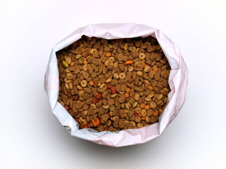 Commercial cat food in a plastic bag on a clear background. photo