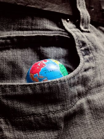 avidity: Globe in the pocket as a metaphor about eternal desire to world possession...