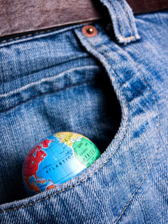 avidity: Globe in the pocket as a metaphor about eternal desire about world possession...