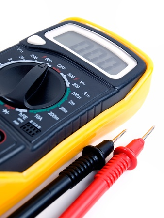 conductor electricity: Modern digital multimeter on a white background.