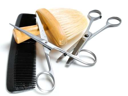 Two different pairs of scissors, barbers brush and comb is basic equipment of each hairdresser.