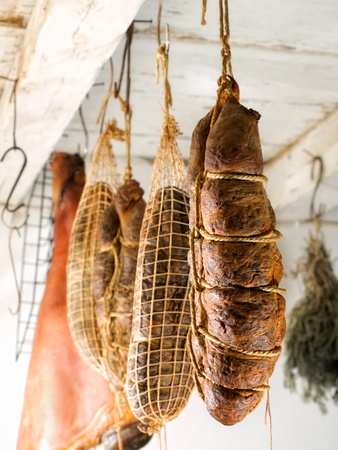 Domestic smoked meat products produced in the traditional way in an old smokehouse.