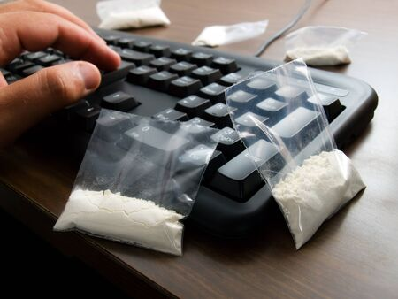 drug trafficking: Conceptual view about drug trafficking over the Internet. Stock Photo
