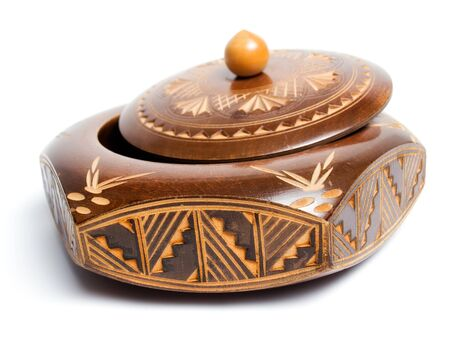 woodcraft: Old carved wooden box with a lid on a white background