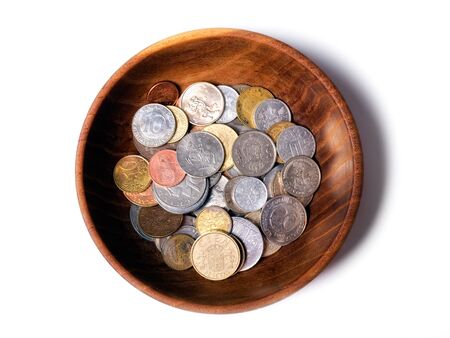 Wooden bowl with old European coins... photo