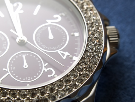 wrist: Closeup view of luxury womans wristwatch.