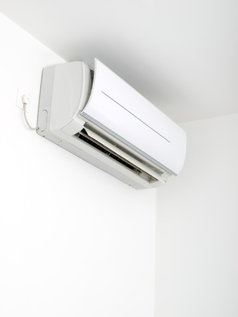 heat home: Plugged air conditioner on the wall... Stock Photo