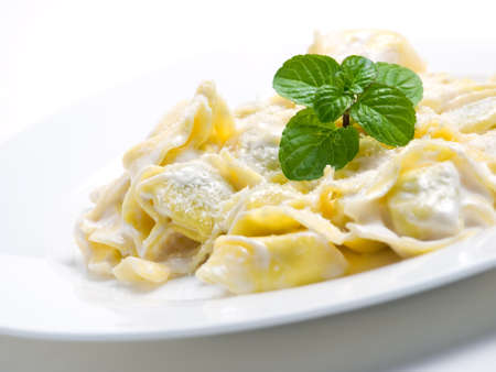 Hot pasta with cheese decorated with mint leaves... Stock Photo - 11270707