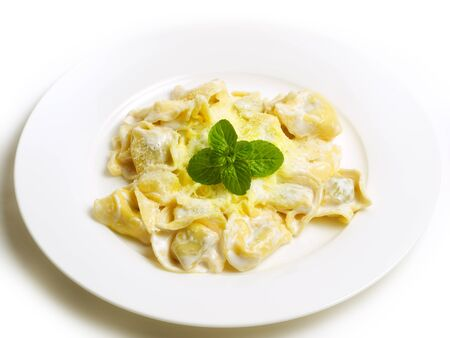 Hot pasta with cheese decorated with mint leaves... photo