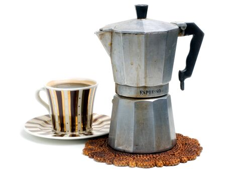 caf: Cup full of black coffee and coffee cooker on a white background. Stock Photo