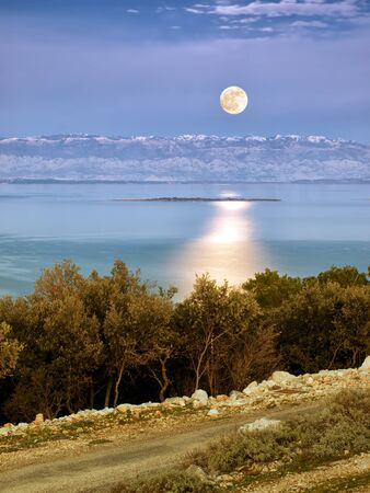 adriatic: Sight on the mountain known as Velebit from the island Losinj in the evening, Croatia... Stock Photo