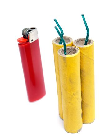 Three firecrackers and lighter on a white background. photo