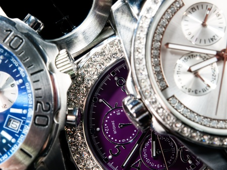 watchmaker: Macro view of many wrist watches.