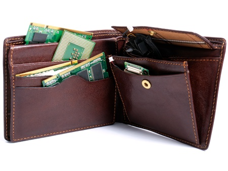 Wallet full of various computer components on a white background. Stock Photo - 12718217