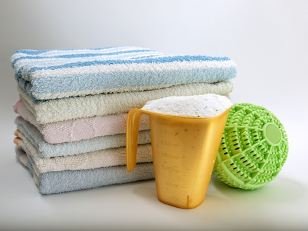 laundromat: Two different ways of washing clothes, with detergent and a modern ball washer