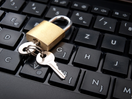 Keys and padlock on the computer keyboard as a data security concept  photo