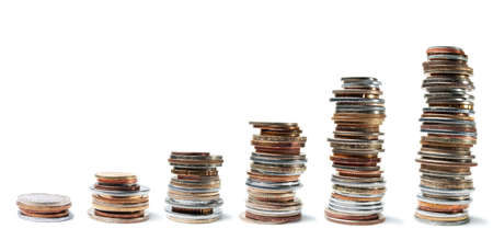 smallest: Columns of various coins from the smallest to the largest on a white background  Stock Photo