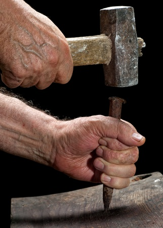 timbering: Carpenter is working with an old hammer and wedge    Stock Photo