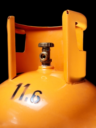 gas cylinder: Closeup view of an orange gas bottle with 11,6 kilos od gas